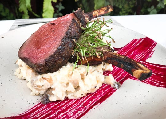 The fennel pollen-dusted venison loin at The Bevy in downtowon Naples is served atop truffle and wild mushroom risotto set on a crisscross of beet puree and garnished with micro fennel.