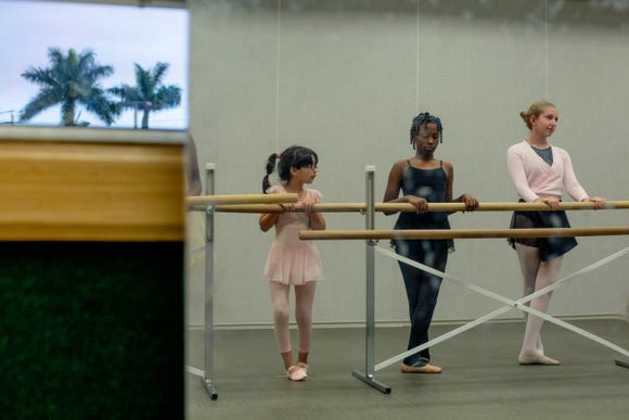 Mariana Morales, Nasha Thereies and Sophia Bosco line up at the barre at their ballet class at Eagle Lakes Community Park in Naples on February 21, 2019. The dancers are preparing for a recital.