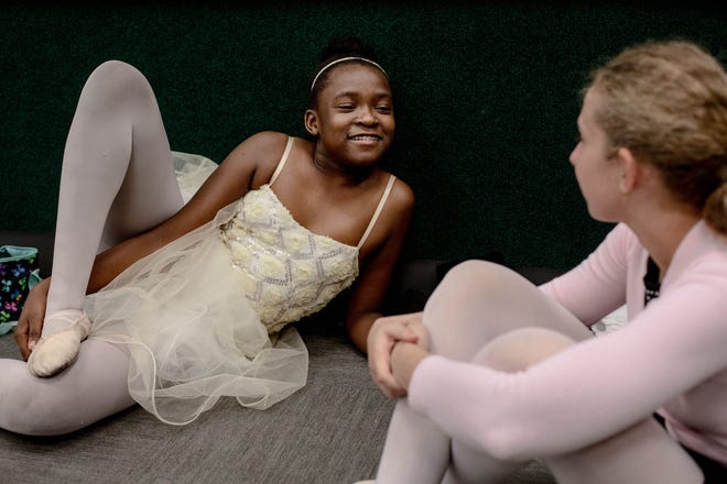 Madney Garraux and Sophia Bosco talk with one another during their ballet class instructed by Marianne Lorusso at Eagle Lakes Community Park in Naples on February 21, 2019.