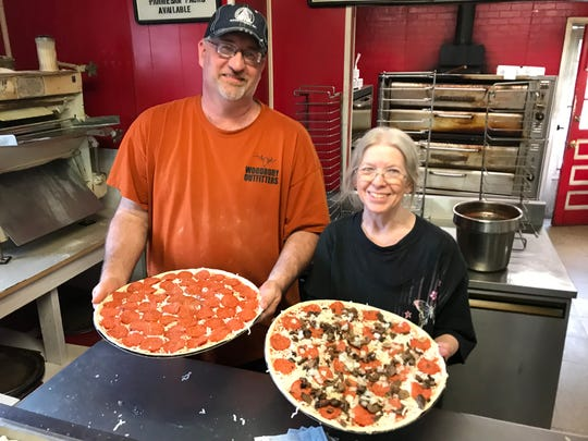 Derek Bennett and Sharon Field working at Park Pizza on Friday, the last day before the popular restaurant closed.