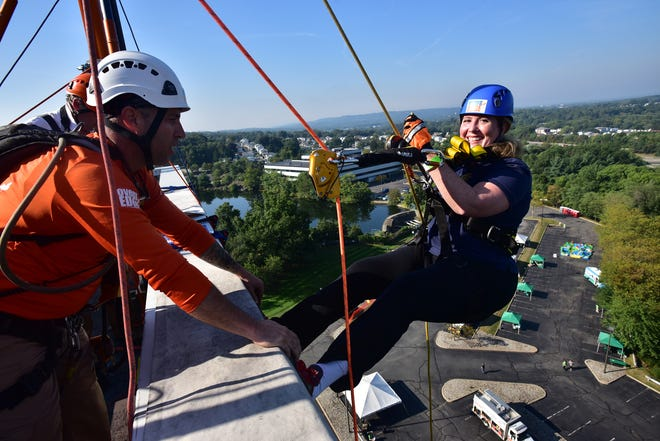 Holly Schepisi, assemblywoman from River Vale, rappelling from a Woodland Park building in September 2015 after recovering from brain surgery.