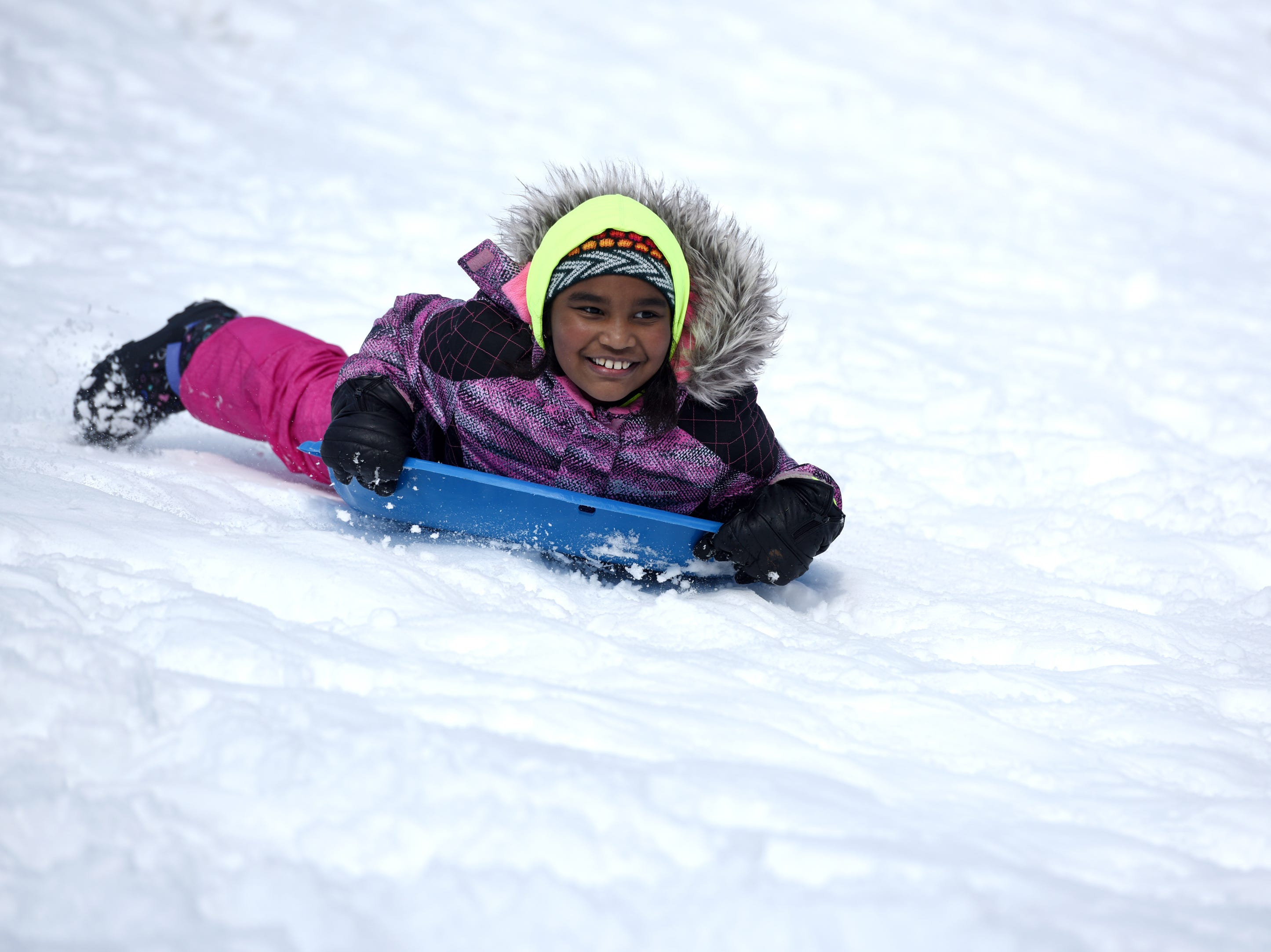 Izabellah Scott, 9, took advantage of a snow day from school with some sledding at Mt. Prospect Park in Clifton on Monday, March 4, 2019.