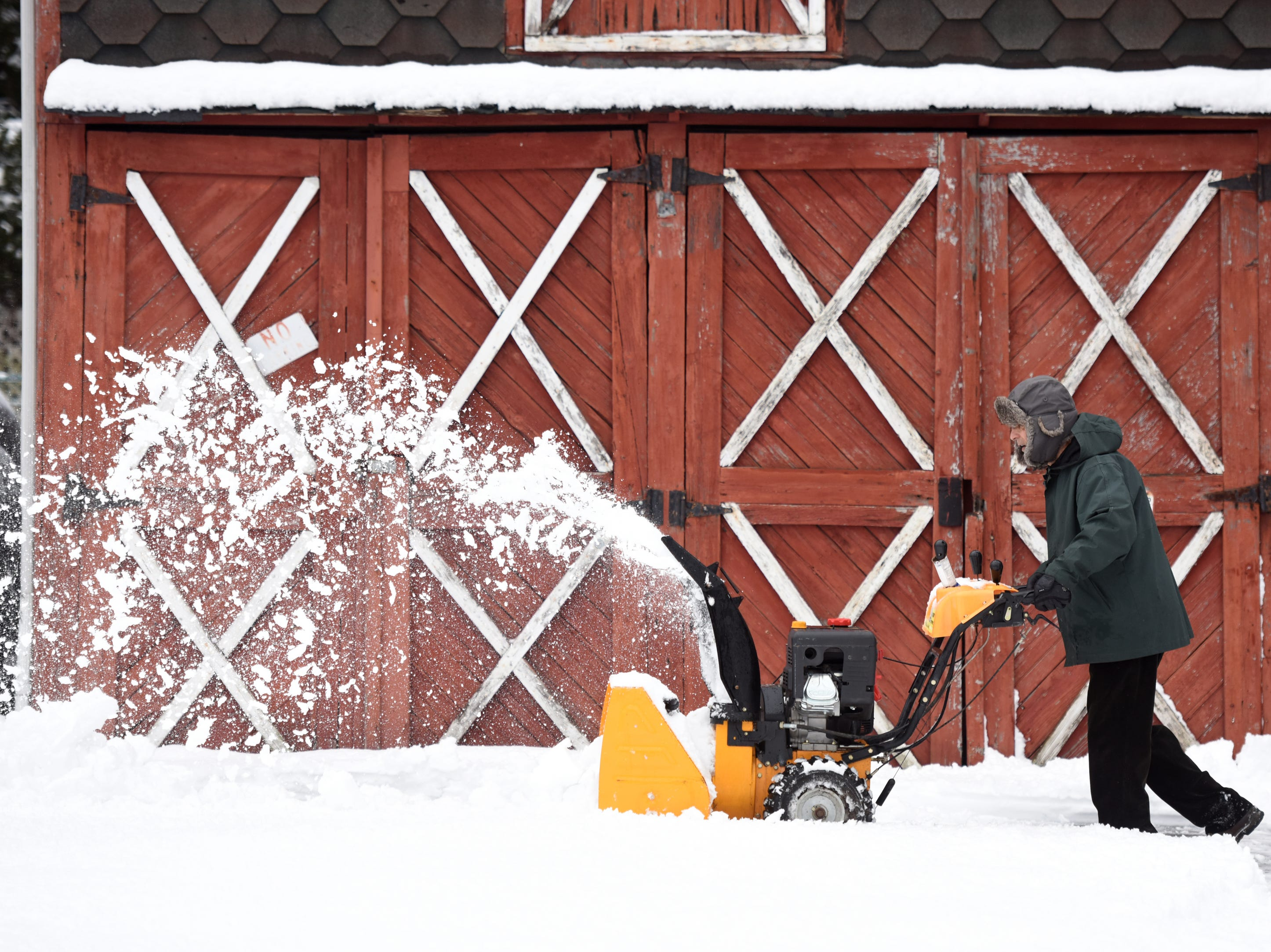 Richard Yelbasi removes snow from his driveway on Elm St. in Clifton on Monday, March 4, 2019.