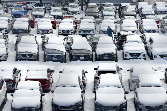 Brian Bakelaar clears the snow from new cars for sale at the Hyundai dealership on Route 4 in Paramus on Monday March 4, 2019.