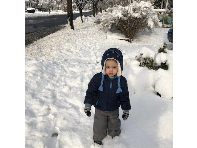 Gavin Gigante enjoys  an early morning walk in the snow on Grant Avenue in Nutley.