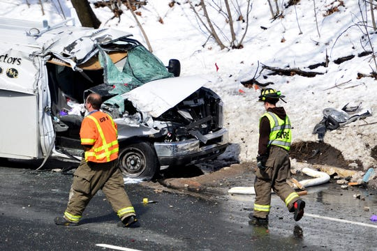 The scene of an accident on Route 208 in Hawthorne after a snowplow driven by a public works laborer fell through a footbridge, onto a northbound utility van.