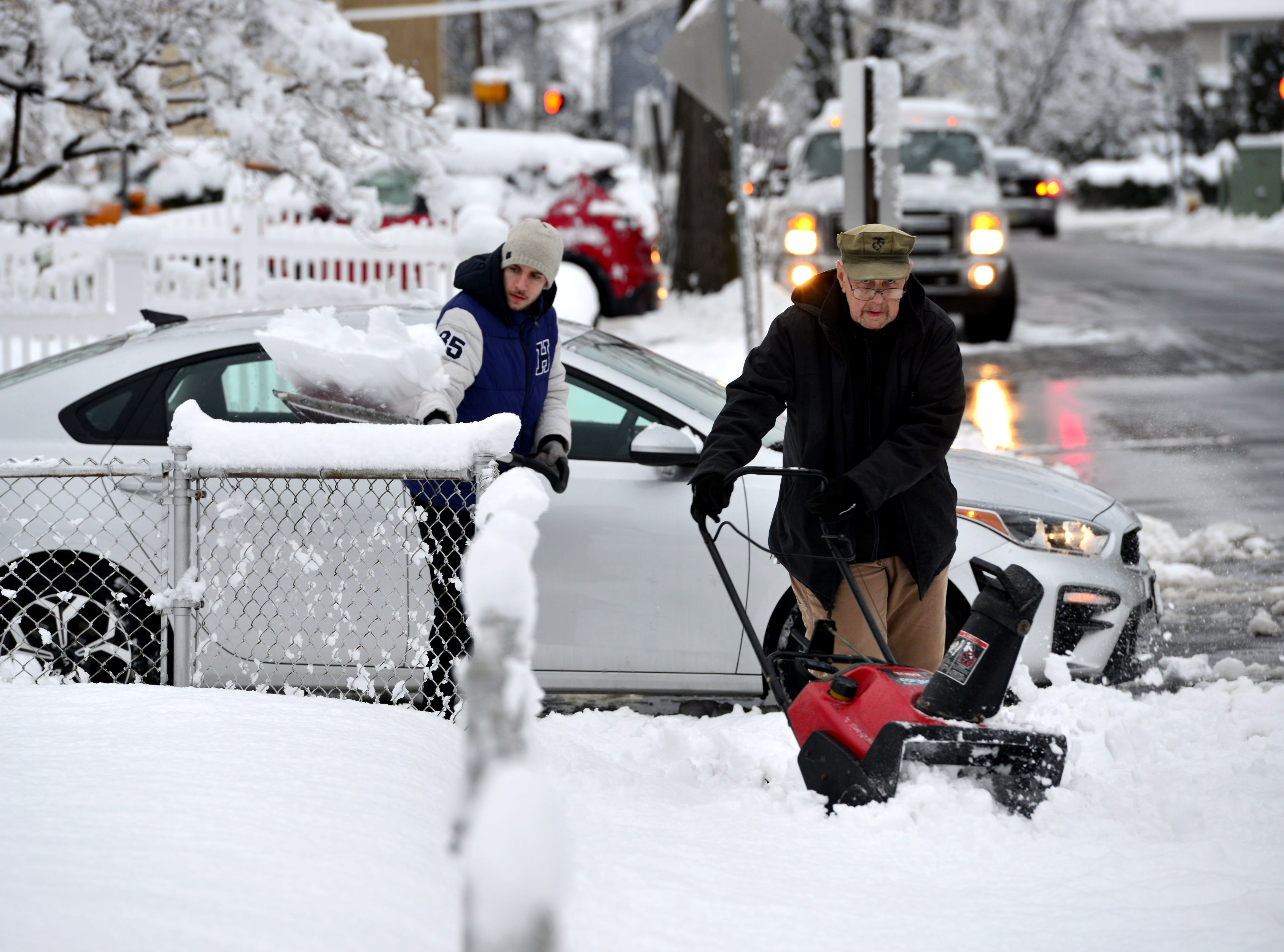Bob Wilson uses a snowblower to clear the sidewalk in front of his home with the help of his grandson Brian Willson in North Arlington on Monday morning March 4, 2019.