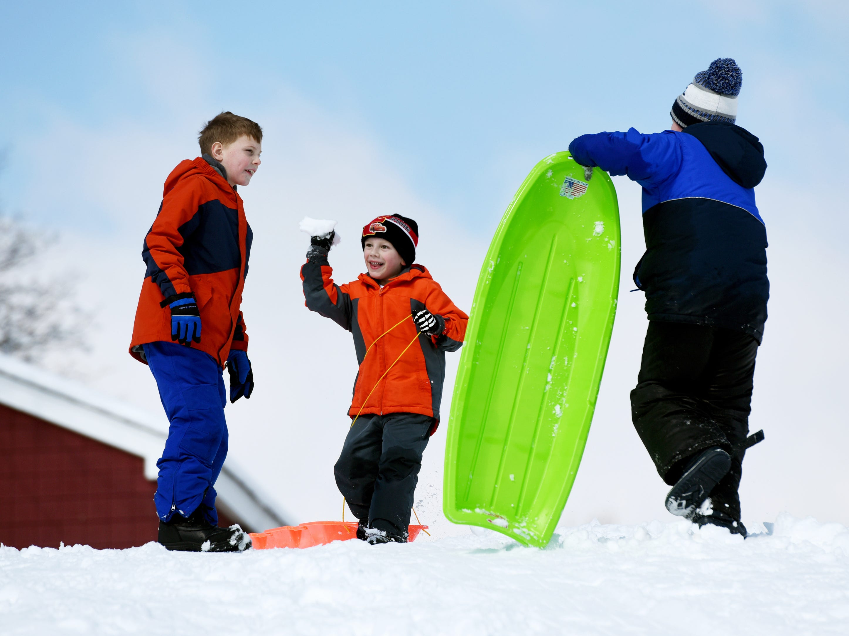 Eric Gibson, 5 throws a snowballs at his brother, Ryan Gibson, 7, during a sledding session at Mt. Prospect Park in Clifton on Monday, March 4, 2019.