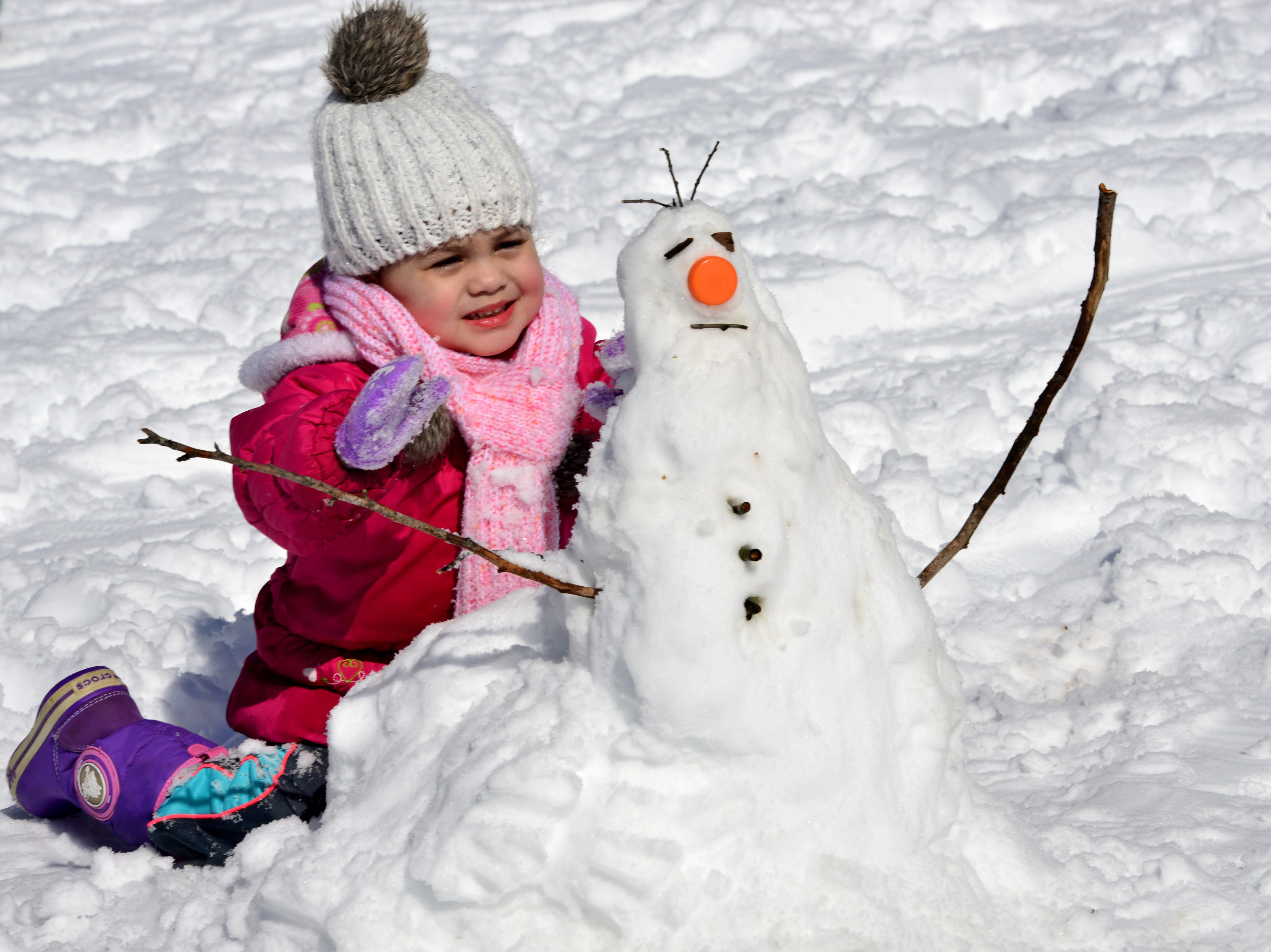 Eliana Luna, 2, of Englewood, makes a snowman she calls Olaf at Van Saun Park in Paramus on Monday March 4, 2019.