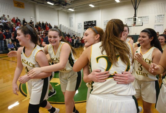 Players of Pascack Valley celebrate their victory as they beat Northern Highlands 36 to 31 in the NJSIAA North 1, Group 3 girls hoops final at Pascack Valley in Hillsdale on 03/04/19.
