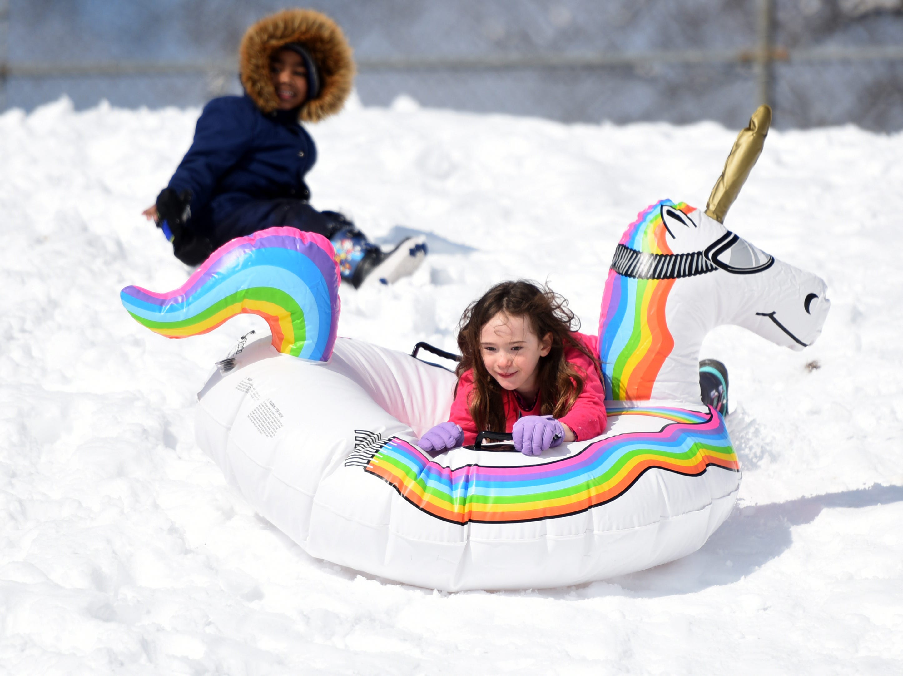 Madison Kane rides her unicorn down the hill while sledding at Mt. Prospect Park in Clifton on Monday, March 4, 2019.