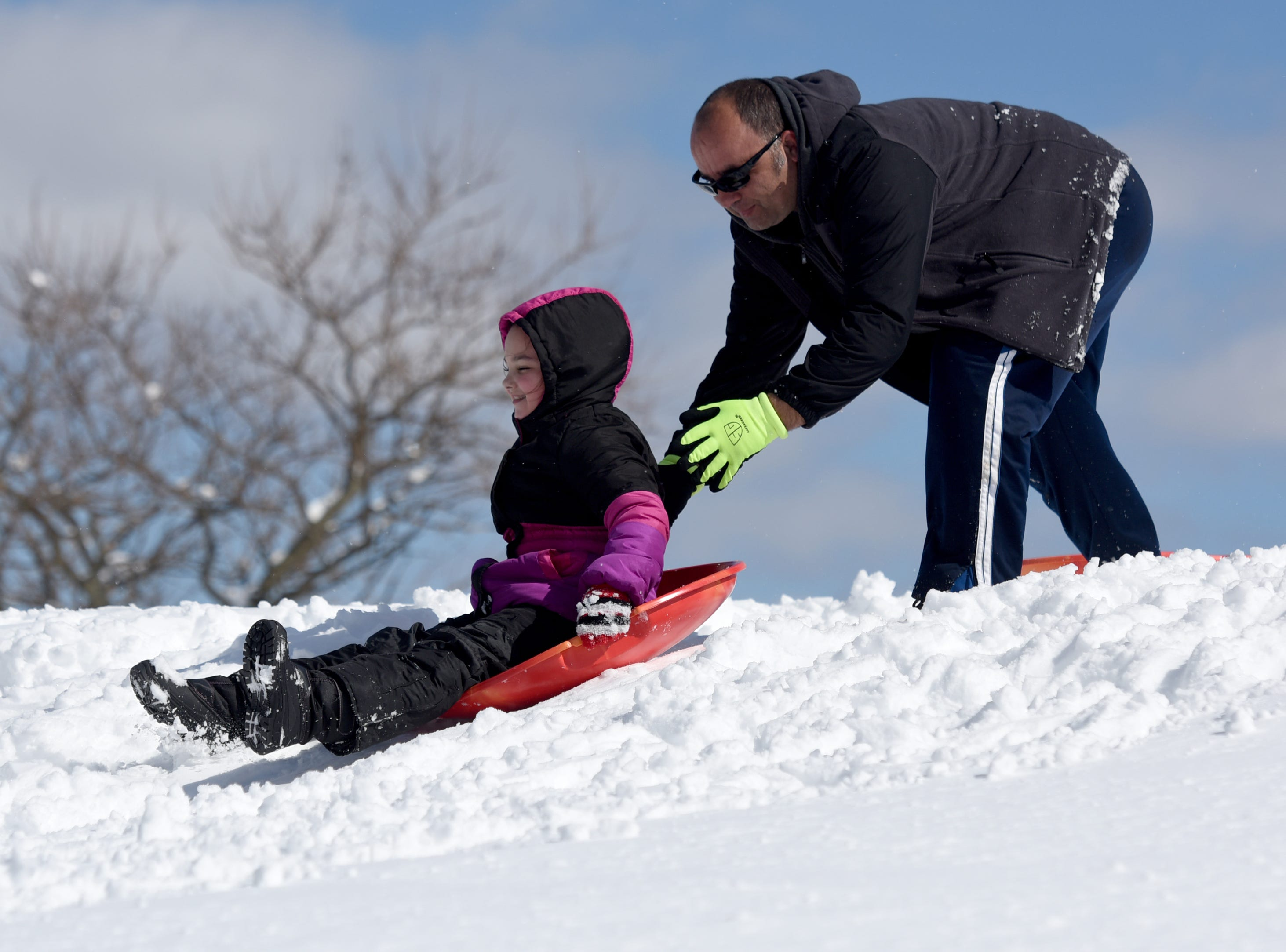Mustaf Gashi gives his daughter Albcona Gashi 8, a push while sledding at Garret Mountain Reservation on Monday, March 4, 2019.