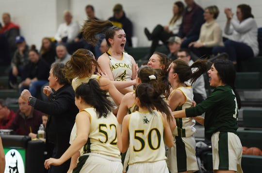 Players of Pascack Valley including Brianna Smith (no.4, C) react as they beat Northern Highlands 36 to 31 in the NJSIAA North 1, Group 3 girls hoops final at Pascack Valley in Hillsdale on 03/04/19.