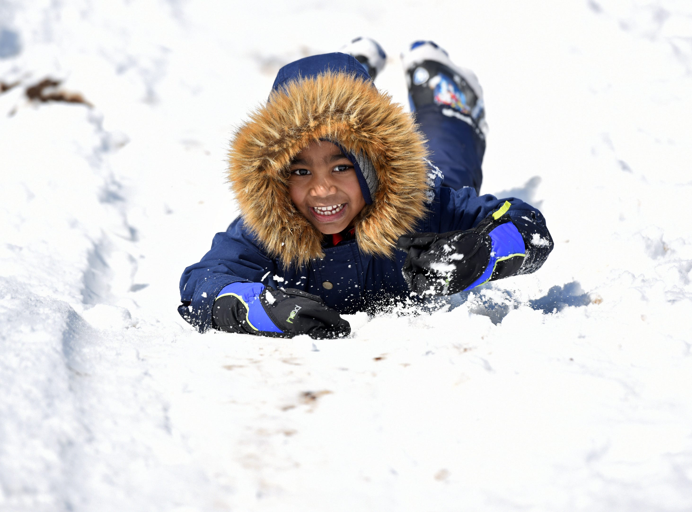 Dyllen Scott, 5, tries out body sledding at Mt. Prospect Park in Clifton on Monday, March 4, 2019.