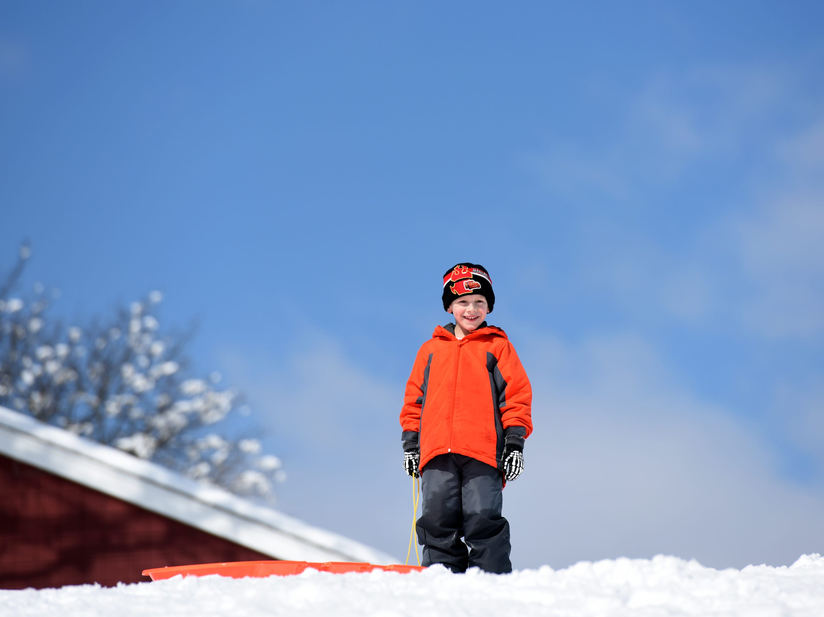 Eric Gibson, 5 takes in the view from atop the sledding hill at Mt. Prospect Park in Clifton on Monday, March 4, 2019.