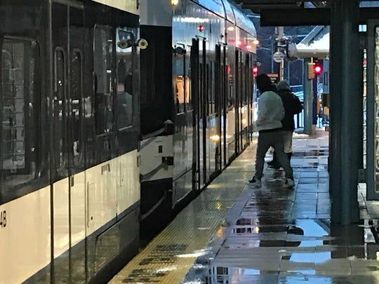 Commuters getting on Hudson-Bergen Light Rail in Hoboken.