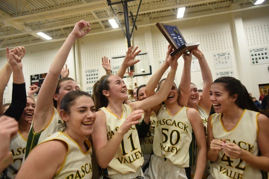 Players of Pascack Valley celebrate their victory with the Championship plaque as they beat Northern Highlands 36 to 31 in the NJSIAA North 1, Group 3 girls hoops final at Pascack Valley in Hillsdale on 03/04/19.
