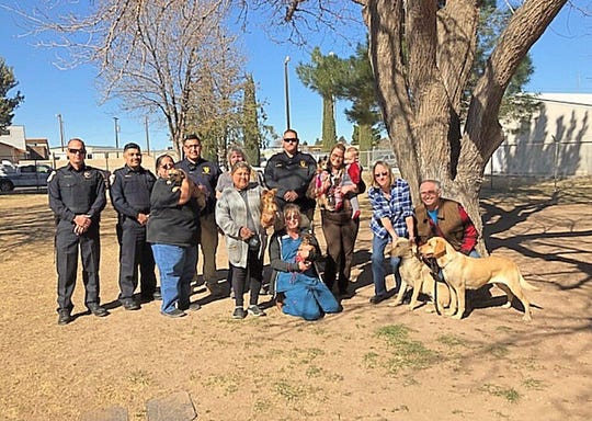 "The Deming Police Department donated to the Deming Animal Guardians microchipping campaign. ""Our community came together during the week of Valentines to show Deming pets some love,"" said Sherry McDaniel. DPD purchased a box of 25 chips. Deming Animal Clinic, High Desert Veterinary Care and Southwest Veterinary Clinic inserted the microchips for free. From left are: Cpt. Hogan, Asst. Chief Valdespino, Cindy Pino and her dog Charlie, Off. Zapata, Mary Salazar, with her dog Canela, Debbie Troyer in back, Officer Jasso, Sherri McDaniel and Sweetie Pie (up for adoption), Deborah Borden and Brayden, with their dog Zima, Deb Quade ,DAG volunteer; and Joe Gillen and his dogs Lavern and Shirley."