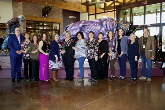 Las Cruces Public Schools Superintendent Greg Ewing, left, and members of the LCPS Board of Education pose with LCPS Educational Support Personnel of the Year semifinalists on Tuesday, Feb. 27, 2019 at the New Mexico Farm & Ranch Heritage Museum.