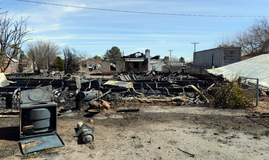 Remains of a double-wide mobile home destroyed by fire in Hatch on Sunday, March 3, 2019.