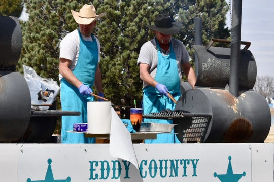 Members of the Eddy County Sheriff's Posse prepare lunch for Riverblitz participants March 2 in Carlsbad.