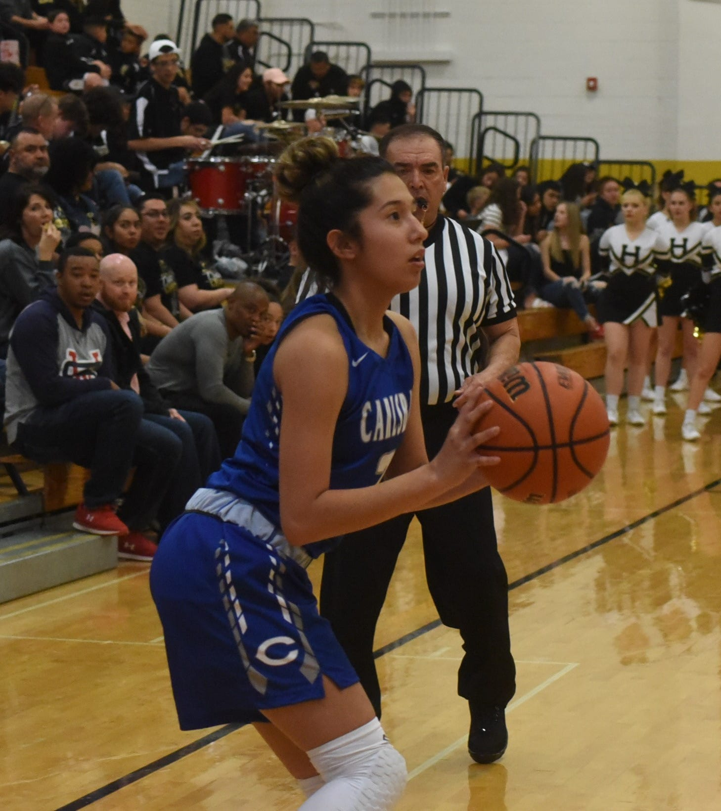 Tori Flores takes a 3-point shot from the corner during Saturday's Class 4-5A district championship game against Hobbs.