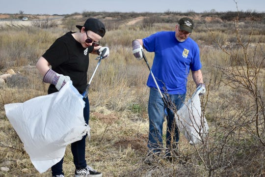 Alex Mager (left) and Donavan Mager clean up during the March 2 Riverblitz in Carlsbad.