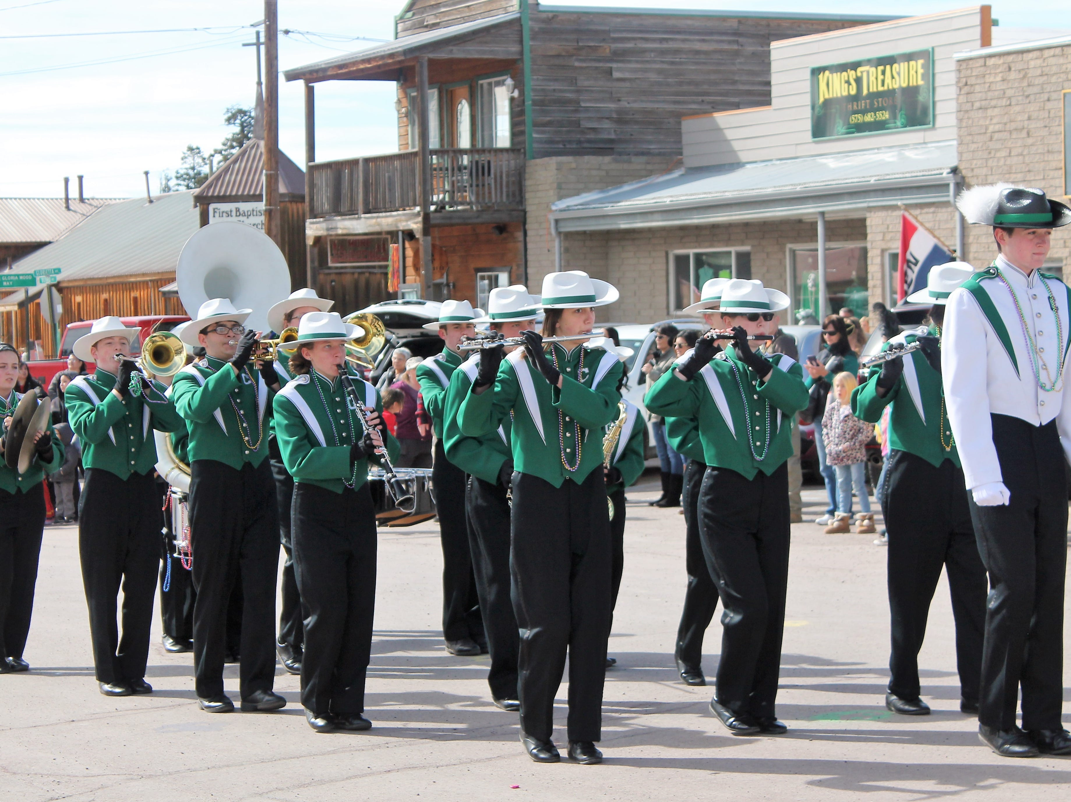 The Cloudcroft High School Marching Band at the Mardi Gras Parade in Cloudcroft Saturday.