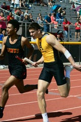 Alamogordo Tiger Daniel Ferenzahlmy completes the boys four by 200 meter relay at the Oñate Invitational held at the Field of Dreams in Las Cruces March 2, 2019. In addition to Ferenzahlmy, Julio Mendoza, Kameron Bebin, and Colin Bell contributed to the Tigers second place finish with a time of 1:33.38.