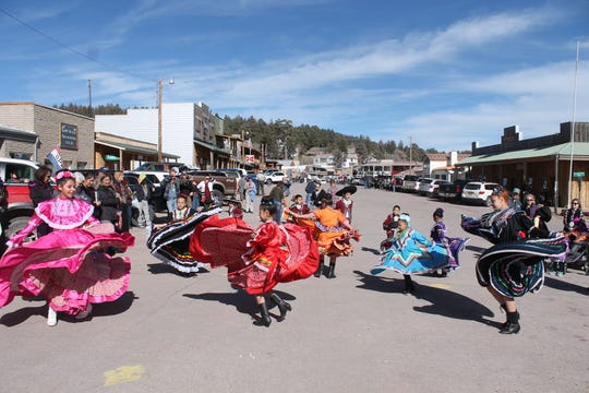 Baile Folklorico perform outside the main tent at Mardi Gras in hte Clouds in Cloudcroft Saturday, March 2.