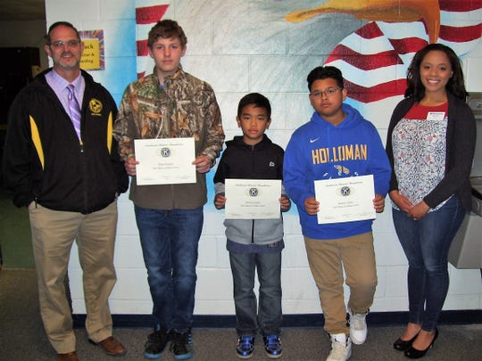 From left to right are Holloman Middle School Principal Steven Starkovich, Blaec Peyton, Jilwin Castillo, Ruben Calero, and Kiwanis Brittani Gandy.