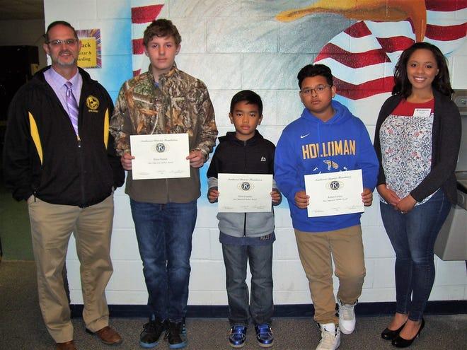From left to right are Holloman Middle School Principal Steven Starkovich, Blaec Peyton, Jilwin Castillo, Ruben Calero, and Kiwanis Brittani Gandy.