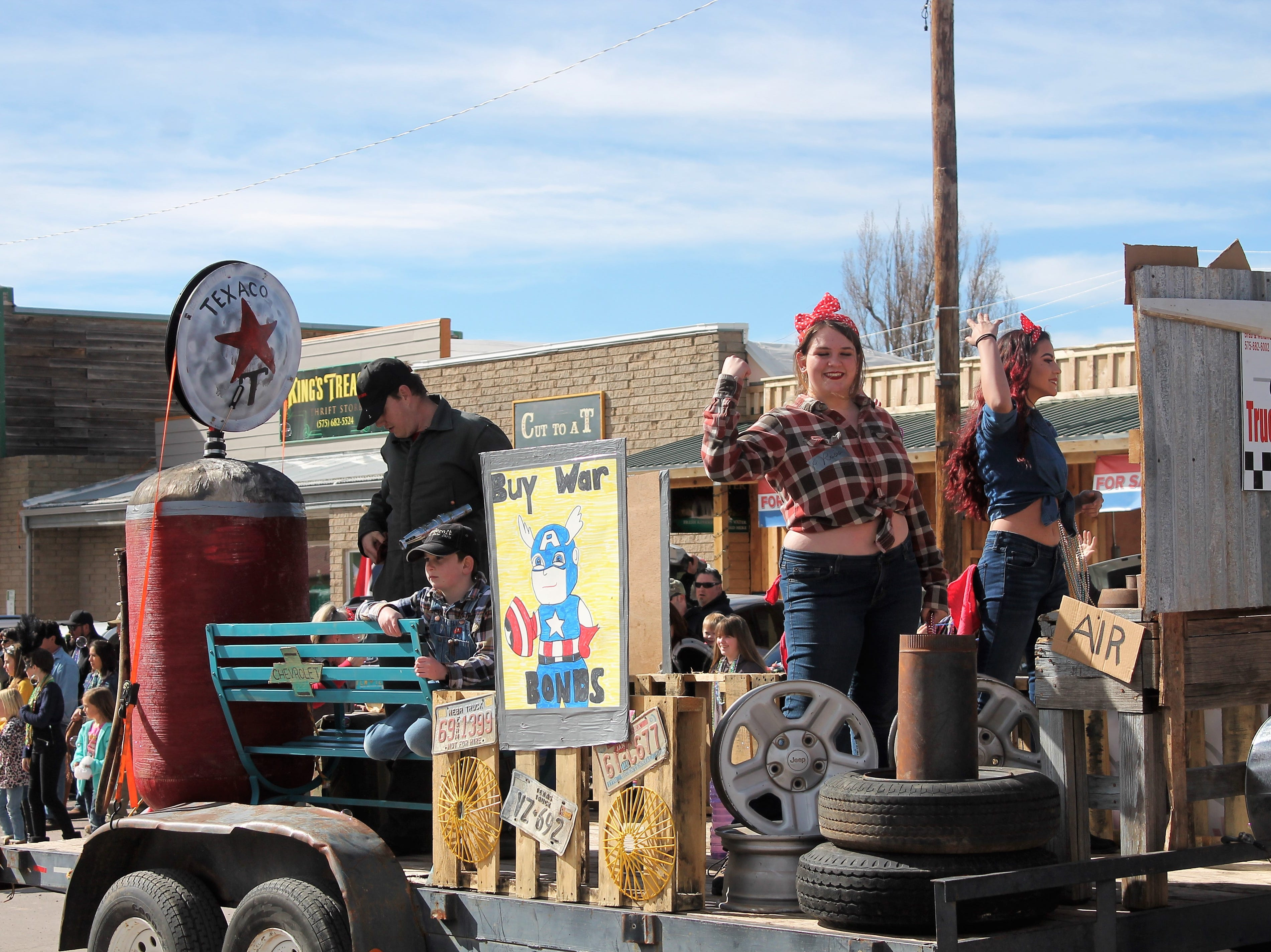 The Cloudcroft Truck and Auto Parts float featured Rosie the Riveters at the Mardi Gras Parade in Cloudcroft Saturday.