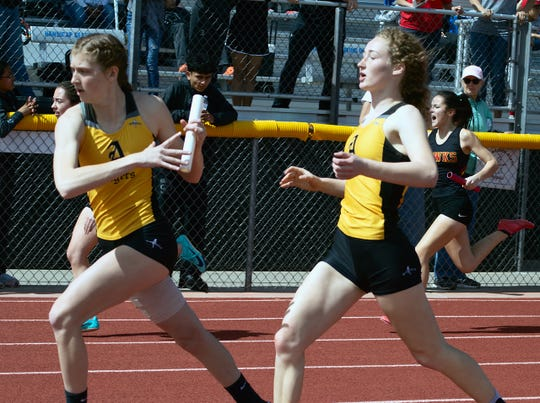 Alamogordo Tiger Claire Myers begins the next leg of the girls four by 400 meter relay following the exchange of the baton with Katie Fillmore at the Oñate Invitational held at the Field of Dreams in Las Cruces March 2. In addition to Myers and Fillmore, Kyra Harrell and Julia Alger contributed to the Tigers first place finish with a time of 51.68 seconds.