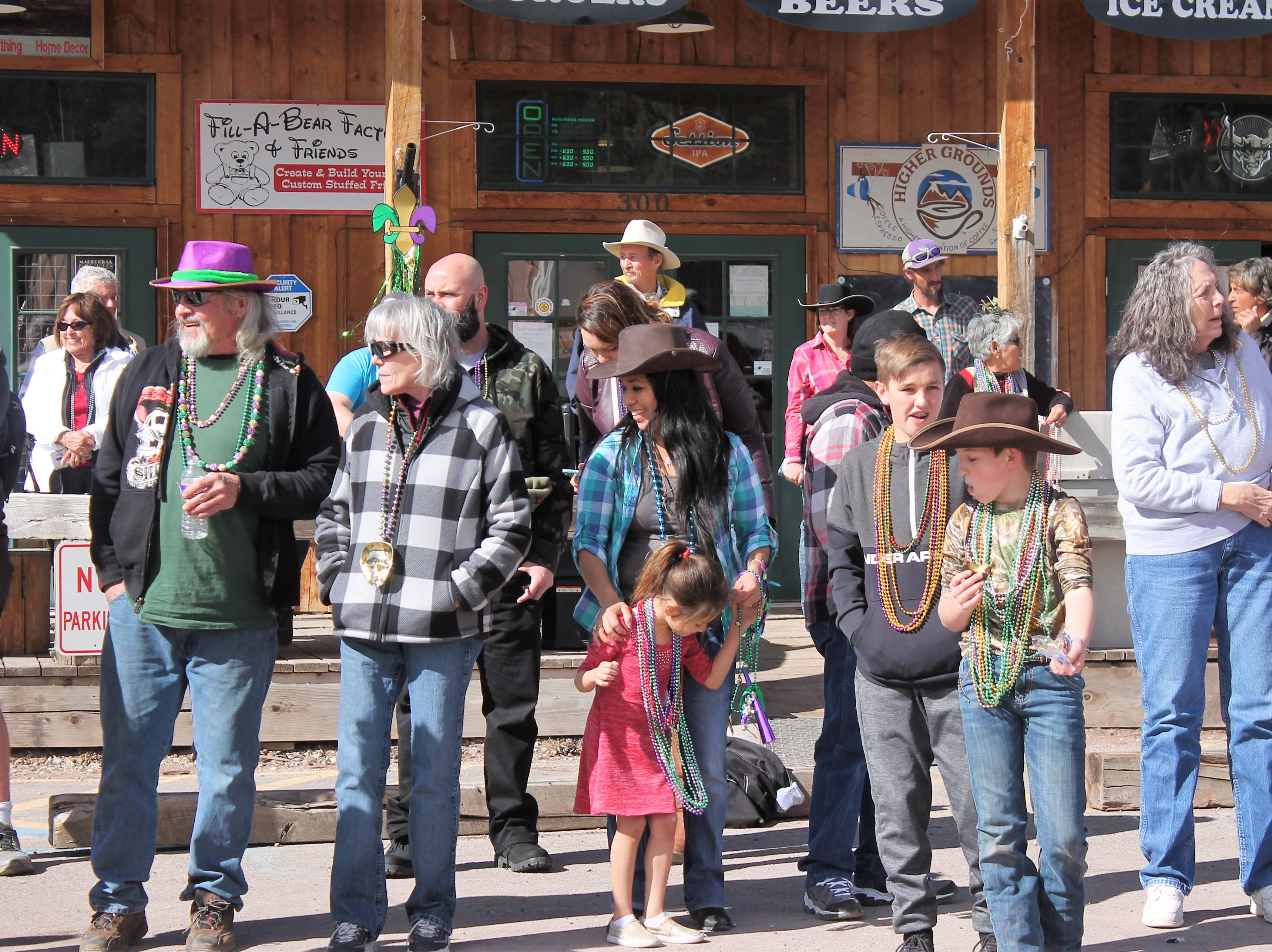 People of all ages were decked out in green and purple at the Mardi Gras Parade in Cloudcroft Saturday.