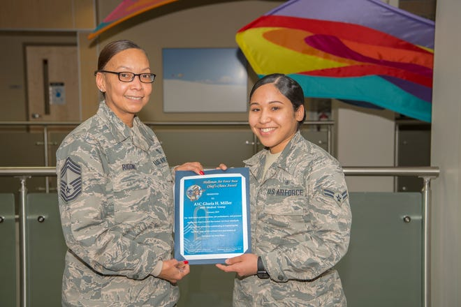 Airman 1st Class Gloria Miller, 49th Medical Support Squadron outpatient records technician, receives the Chief's Choice Award from Chief Master Sgt. Rhonda L. Riggins, 49th Medical Group superintendent, Feb. 21, on Holloman Air Force Base, N.M. Miller was selected due to her attention to detail and expert execution in her daily duties.