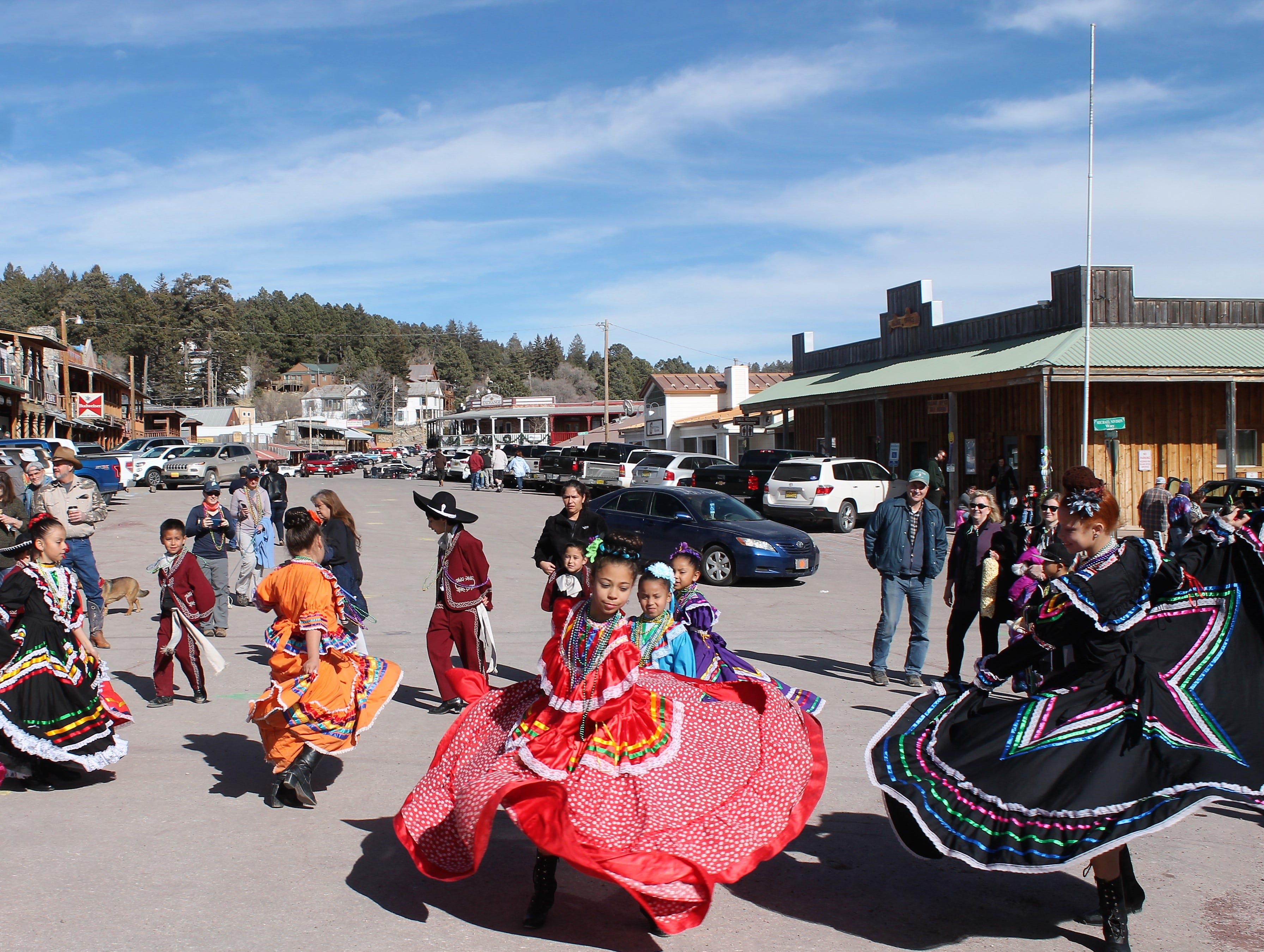 Members of Baile Folklorico dance on Burro Avenue during the Cloudcroft Chamber of Commerce's Mardi Gras in the Clouds Saturday.