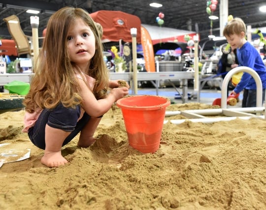 Avery Thom, of St. Clair Shores, plays in a giant sand box at last year's Outdoorama at Novi's Suburban Collection Showplace.
