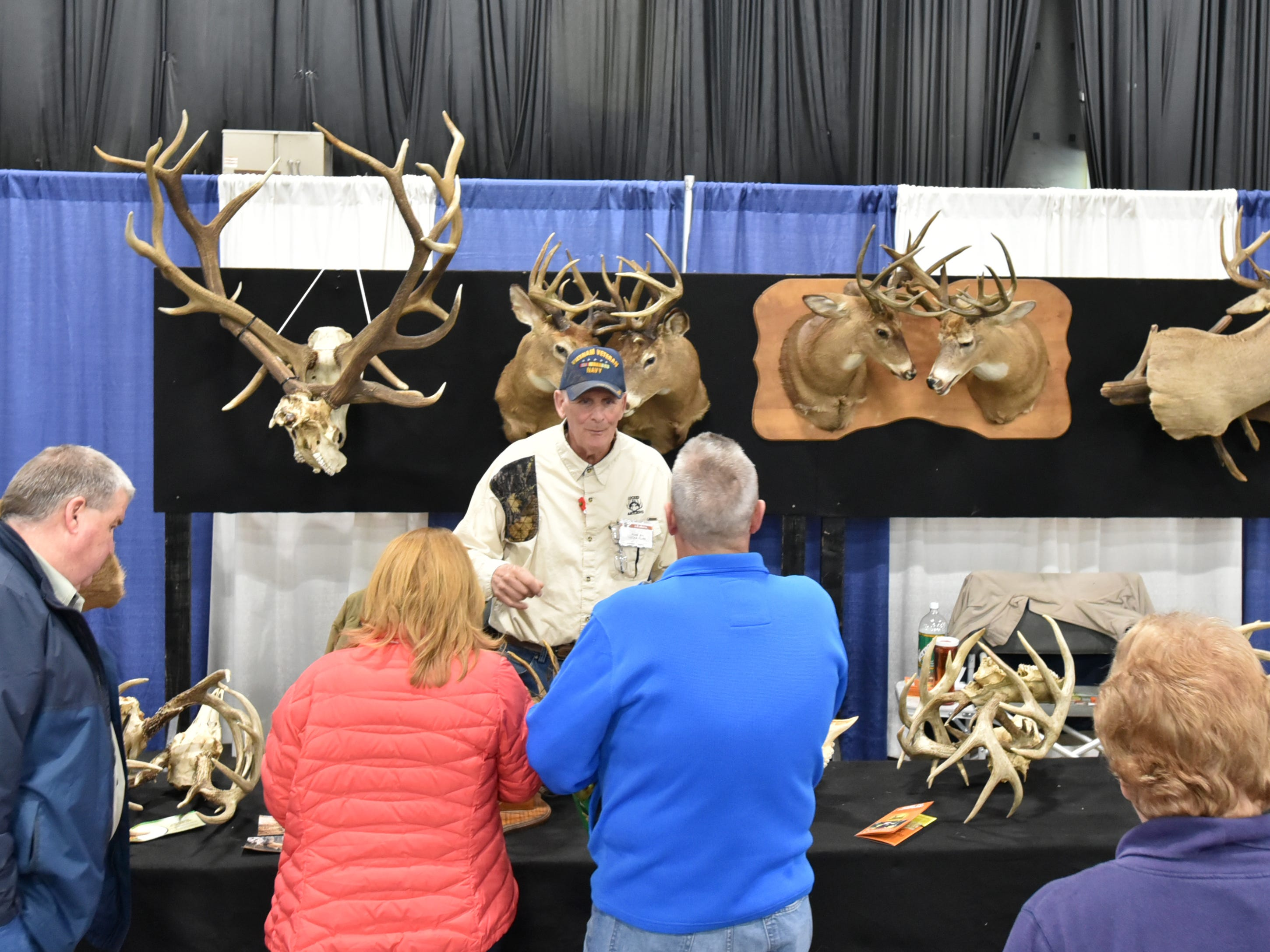 Ron Foss greets visitors to his display at the Outdoorama.