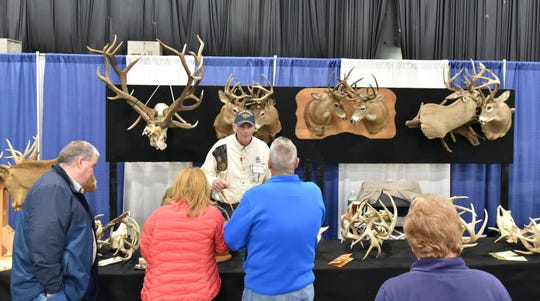 Ron Foss greets visitors to his display at last year's Outdoorama.
