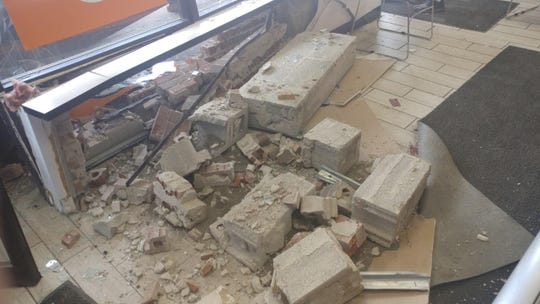 Damage to the interior of the Little Caesars waiting area was extensive.