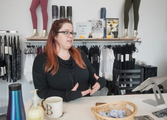 Owner Briana Knight talks Monday about the new Disko Lemonade fitness studio and Lululemon apparel boutique at 120 S. Jefferson St. in downtown Pensacola.