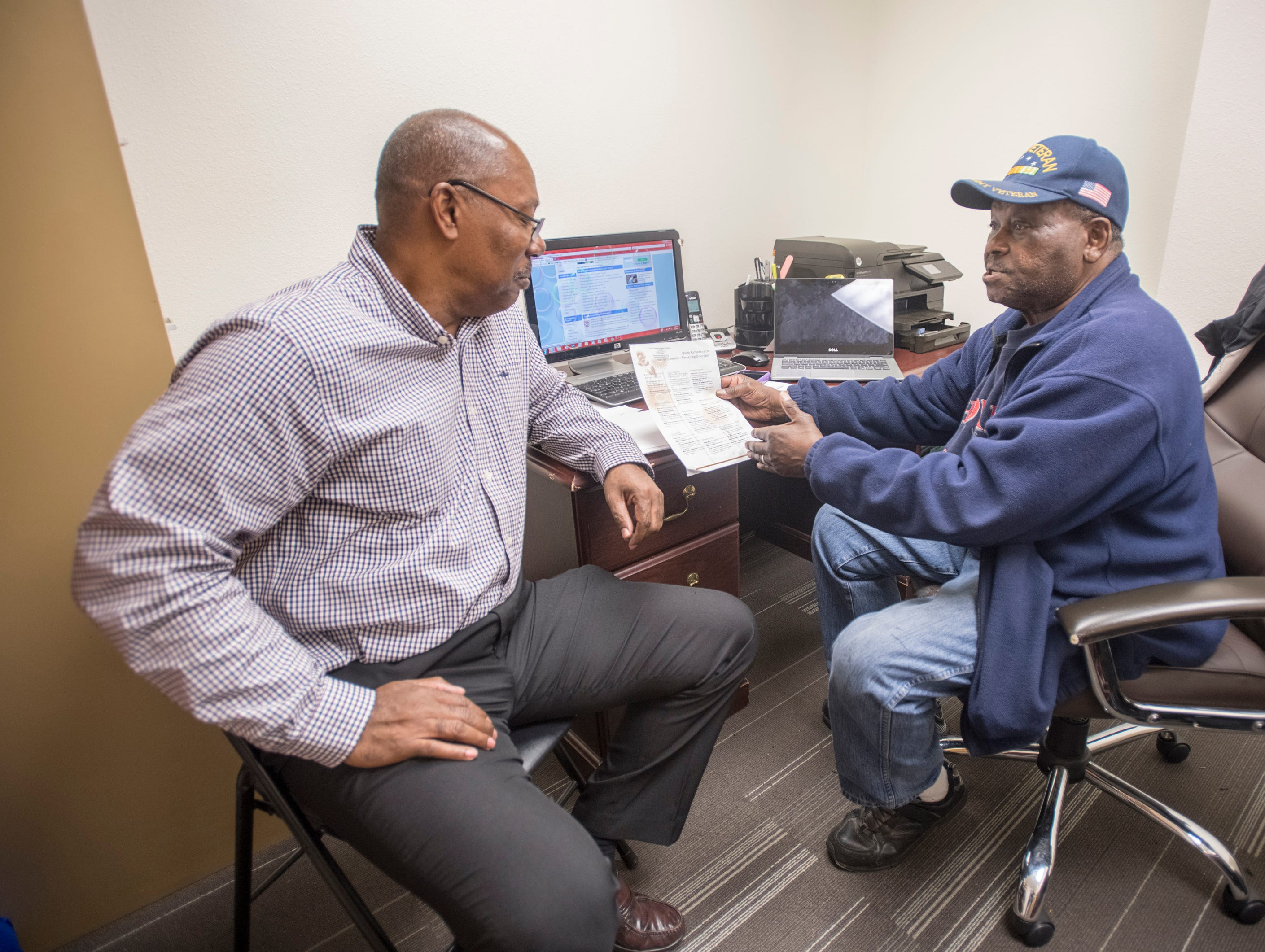 Gary Reynolds, left, and Walter Wallace, Sr. work in the Sickle Cell Disease Association office in downtown Pensacola on Monday, March 4, 2019.