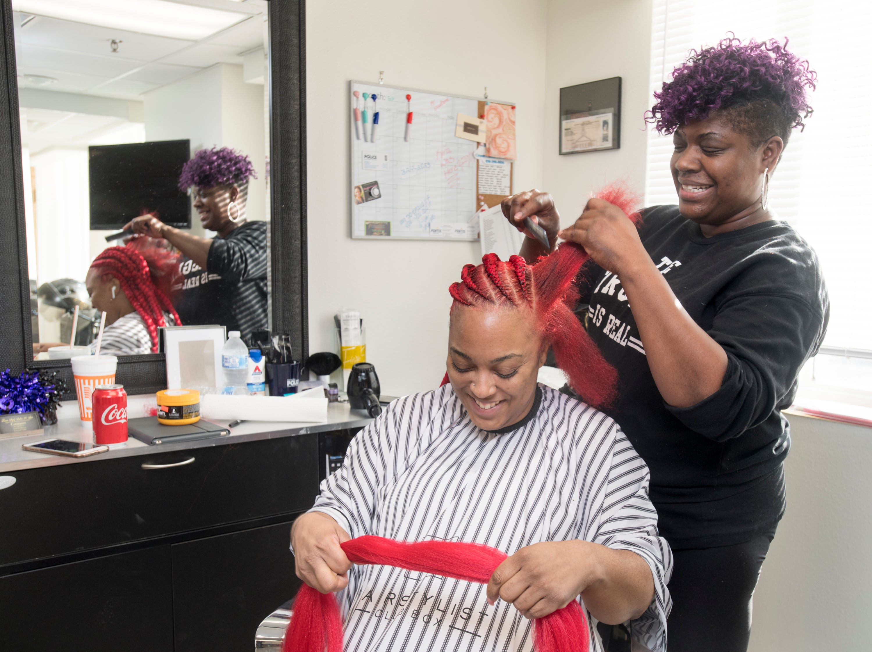 Owner Constance Faxon styles Kira Wilson's hair at Faxon Stylz Salon & Spa in  downtown Pensacola on Monday, March 4, 2019.