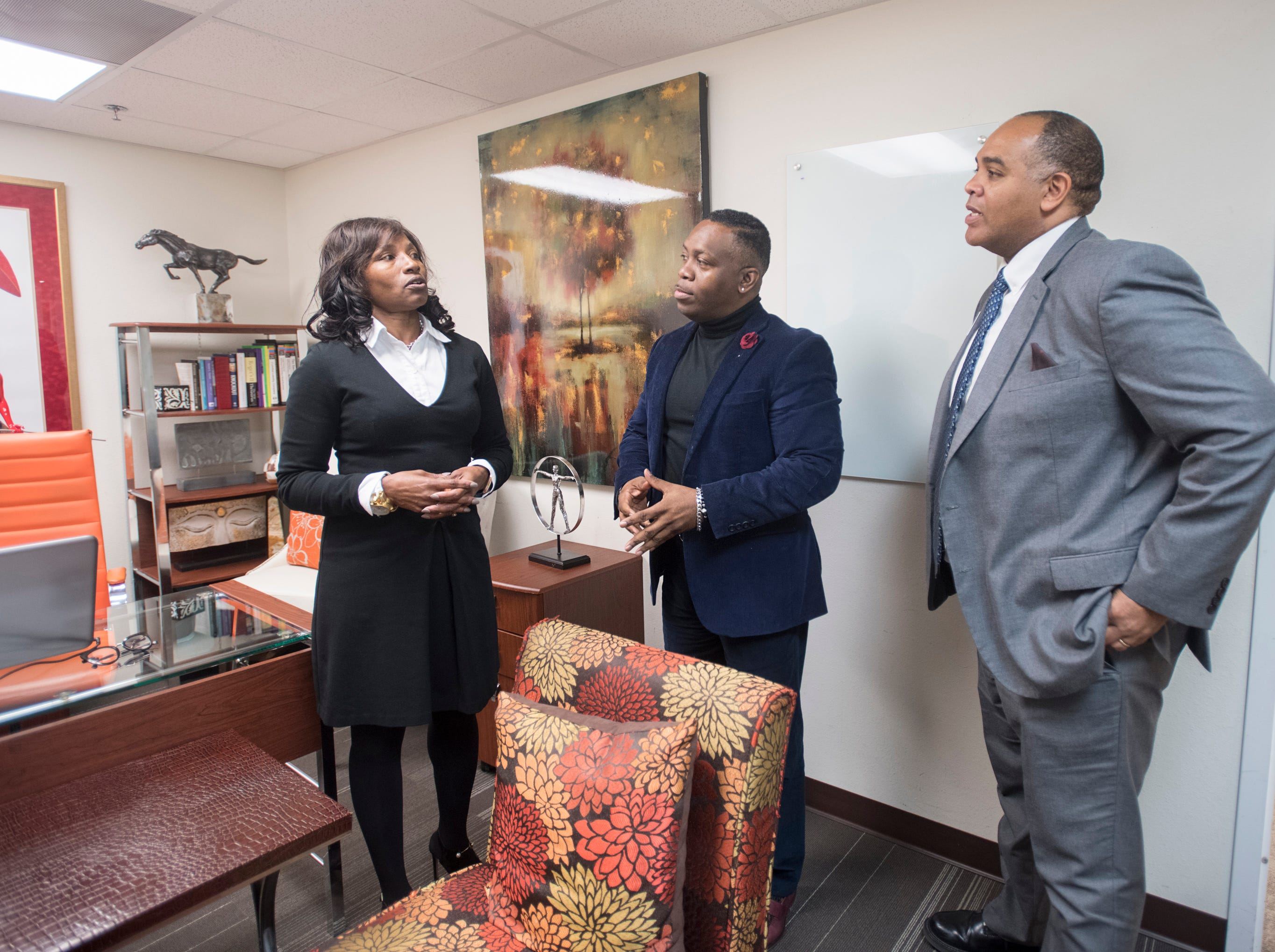 Brian Wyer, President/CEO of the Gulf Coast Minority Chamber of Commerce, right, talks with Jessica Griffen, chairwoman & CEO, and John Rigsby, president of the Urban Development Center, in downtown Pensacola on Monday, March 4, 2019.