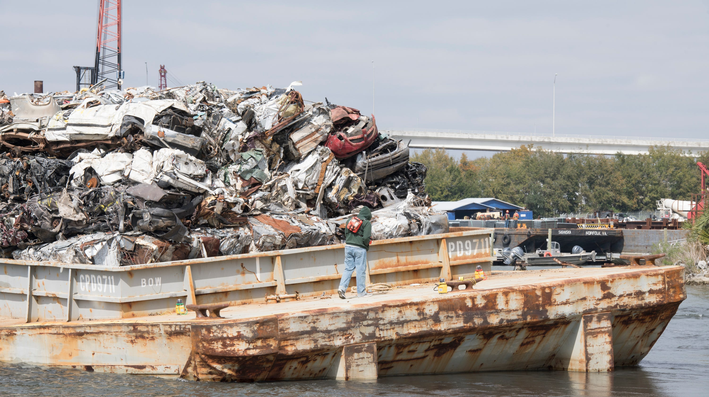 Barges carrying crushed cars run aground in Bayou Chico