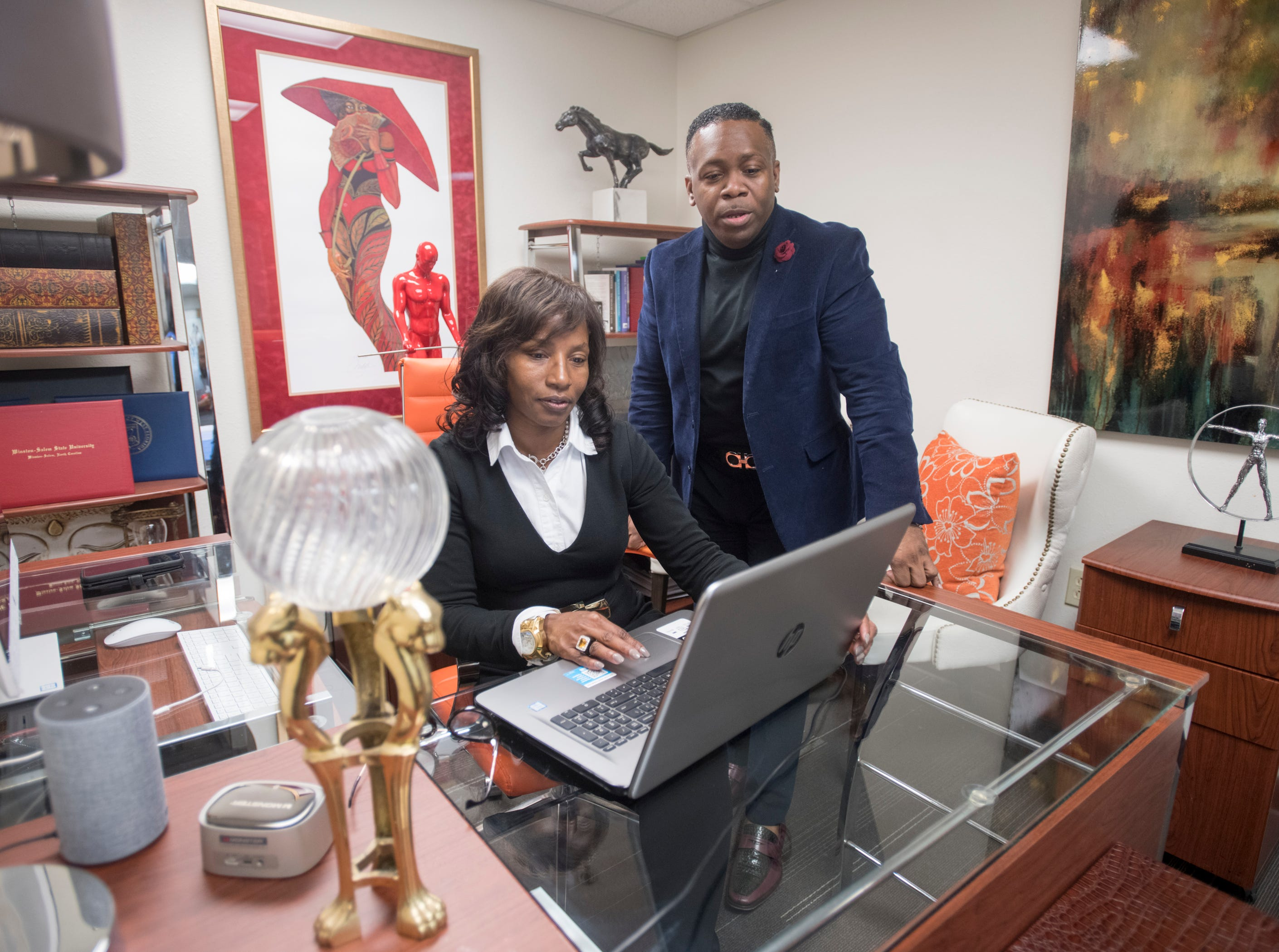 Jessica Griffen, chairwoman & CEO, and John Rigsby, president, work in the Urban Development Center in downtown Pensacola on Monday, March 4, 2019.