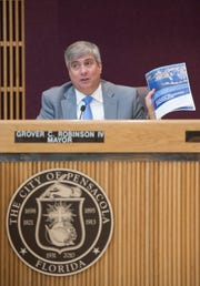 Mayor Grover Robinson speaks during the mayoral transition meeting at City Hall in Pensacola on March 4.