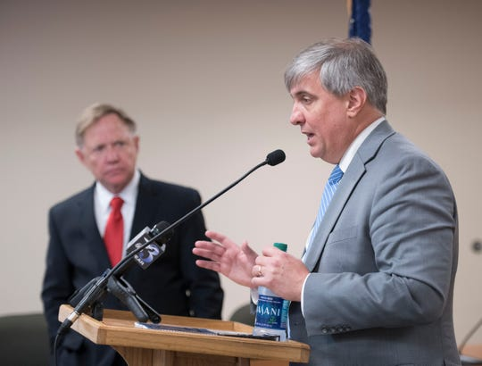Mayoral transition team chair Quint Studer, left, listens as Mayor Grover Robinson holds his weekly press conference at City Hall in Pensacola on Monday, March 4, 2019.