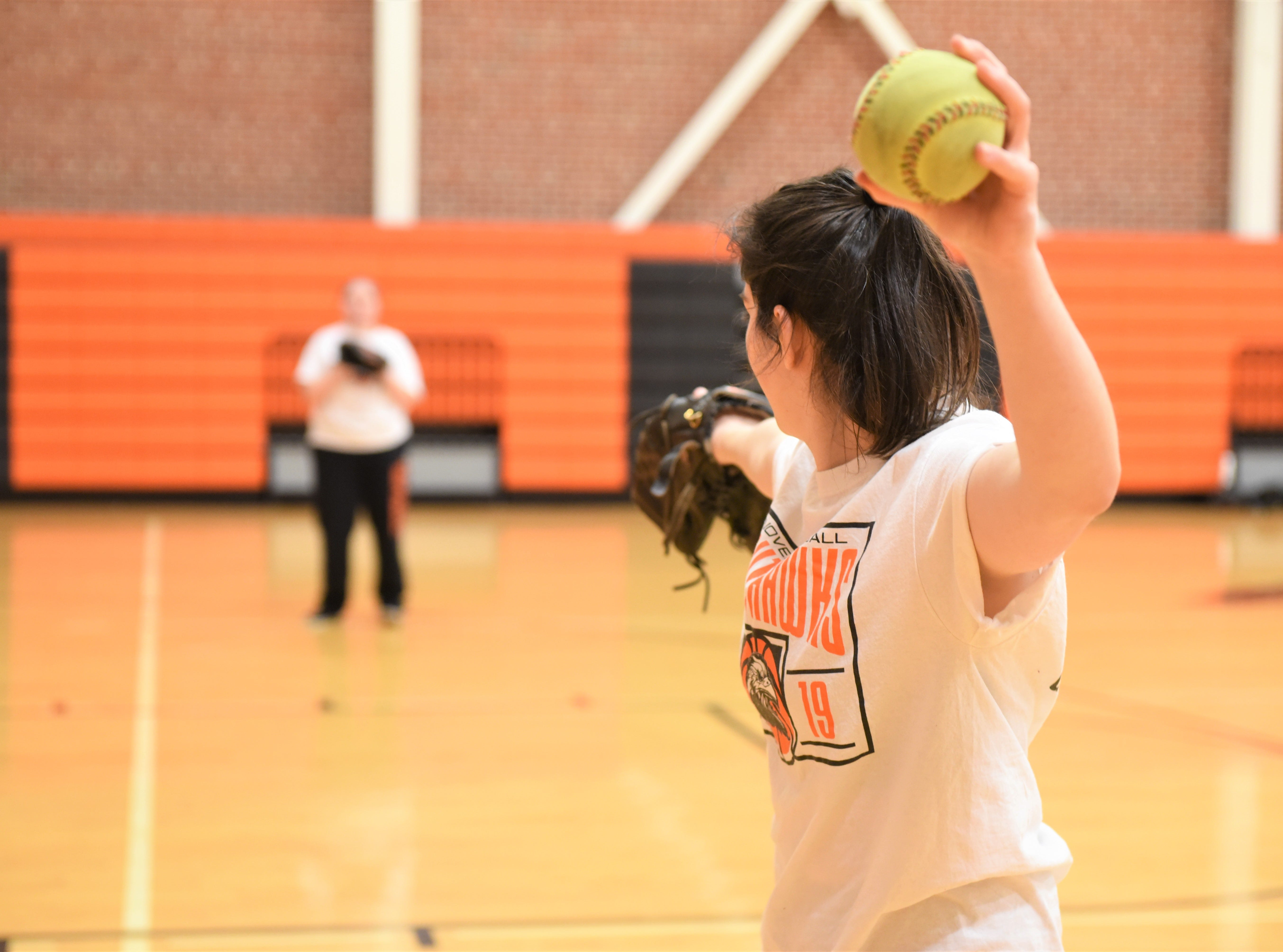 Hanover Senior High School softball team practices their throws and catches at the first practice of the spring sports season on March 4, 2019.